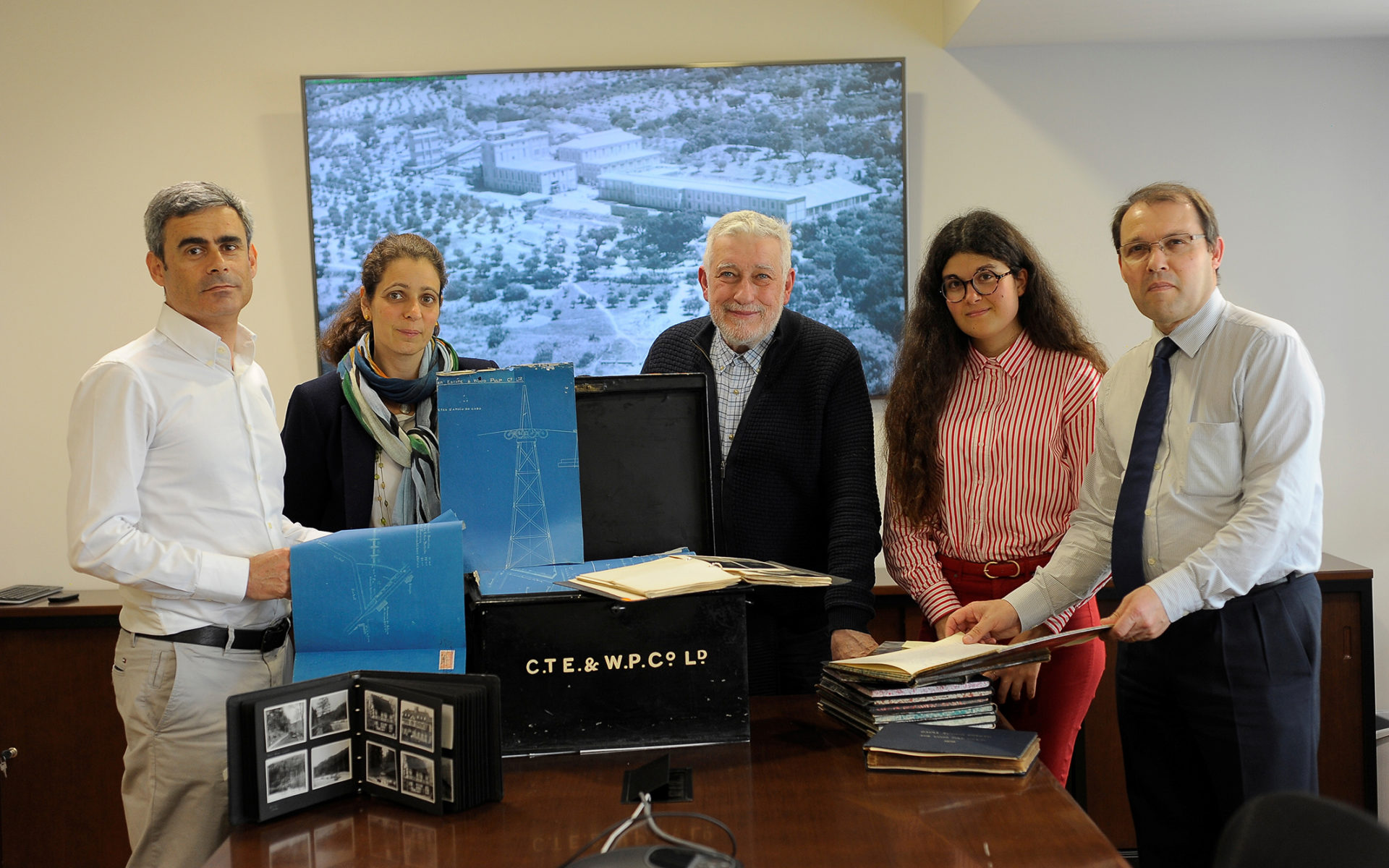 Gualter Vasco, factory manager of Caima (left) with Luis Patornilho, head of human resources at Caima (right), and the team of industrial archeologists